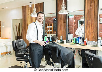 Barber Smiling While Hair Styling Customer In Shop