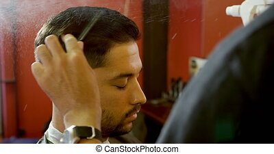 Barber styling clients hair with comb 4k - Barber styling...