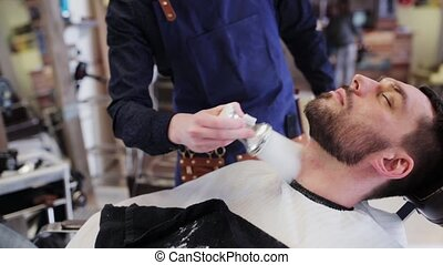 barber with brush applying talc to male neck
