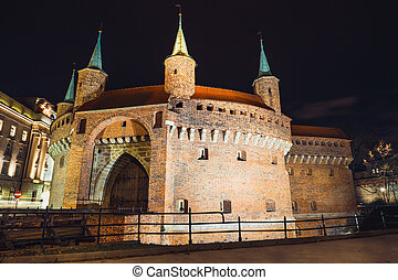 Barbican fortress in the historic center of Krakow at night, Poland