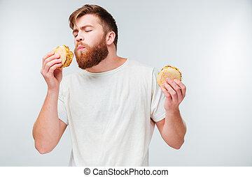 barbudo, comer, desfrutando, excitado, hamburgers, homem