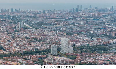 Barcelona and Badalona skyline with roofs of houses and sea on the horizon at evening timelapse
