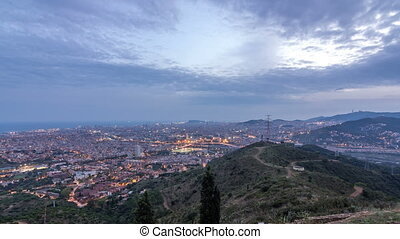Barcelona and Badalona skyline with roofs of houses and sea on the horizon day to night timelapse