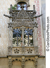 Barcelona architecture - intricate stonework on a window in...