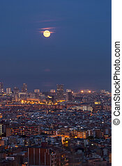 Barcelona at night with full moon, Catalunya, Spain