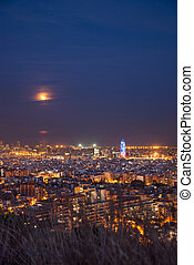 Barcelona at night with full moon and torre agbar, Catalunya, Spain