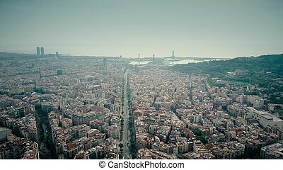 Barcelona city aerial shot, Spain. Distant sea port