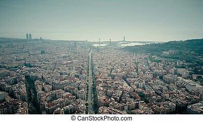 Barcelona city aerial shot, Spain. Distant sea port