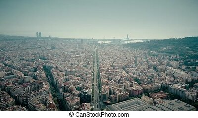 Barcelona city aerial shot, Spain. Distant sea port. 4K...