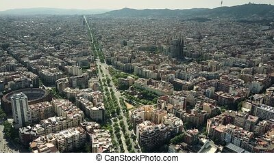 Barcelona city aerial view on a sunny day, Spain. Famous Sagrada Familia - Basilica and Expiatory Church of the Holy Family. 4K shot