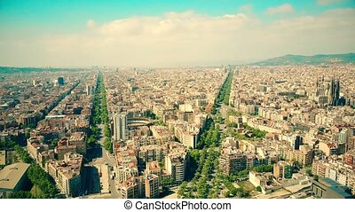 Barcelona city aerial view on a sunny day, Spain. Famous Sagrada Familia - Basilica and Expiatory Church of the Holy Family. 4K video