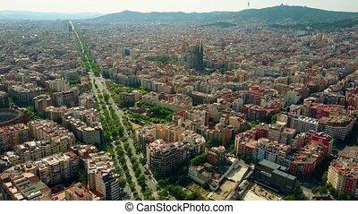 Barcelona city rising aerial shot, Spain. Sagrada Familia - Basilica and Expiatory Church of the Holy Family. 4K clip