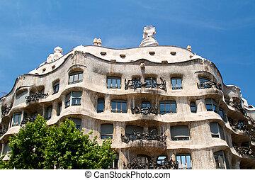 BARCELONA - May 26: Casa Mila La Pedrera builbing on May 26, 2011 in Barcelona. Casa Mila is one of buildings created by Antonio Gaudi. It is very popular landmark in Barcelona.
