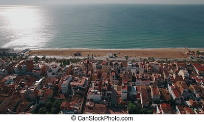 Barcelona on the coast of Mediterranean Sea, aerial shot