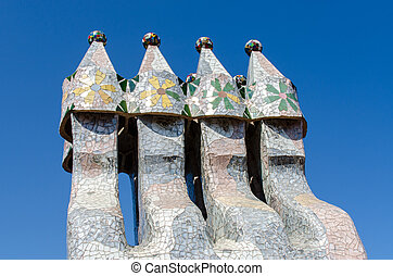 BARCELONA, SPAIN - JULY 19: Chimneys like masked soldiers on the roof of La Pedrera or Casa Mila designed by Antoni Gaudi, on July 19, 2012 in Barcelona, Spain. La Pedrera was built in 1906-1910.