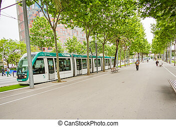 BARCELONA, SPAIN - MAY 31 People walking in the morning to the work and a tram passing in Diagonal Avenue, in Barcelona, Spain, on May 31, 2013