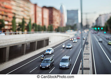 tilt and shift abstract shot of traffic in barcelona spain at sunset