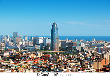 Barcelona`s skyline with skyscrapers including Torre Agbar.