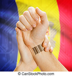 Barcode ID number on wrist and national flag on background - Andorra