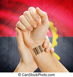 Barcode ID number on wrist and national flag on background - Angola