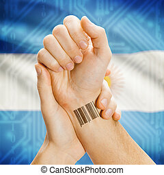Barcode ID number on wrist and national flag on background - Argentina
