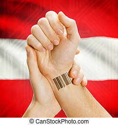 Barcode ID number on wrist and national flag on background - Austria