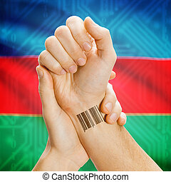 Barcode ID number on wrist and national flag on background - Azerbaijan