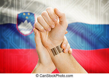 Barcode ID number on wrist and national flag on background...