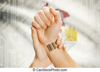 Barcode ID number on wrist and USA states flags on background - Illinois