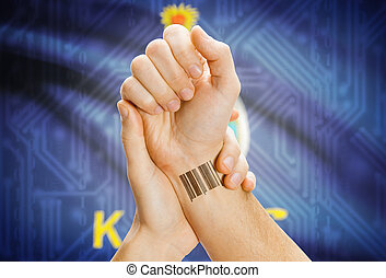 Barcode ID number on wrist and USA states flags on background - Kansas