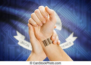 Barcode ID number on wrist and USA states flags on background - Louisiana
