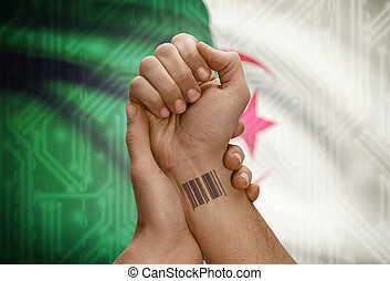 Barcode ID number on wrist of dark skinned person and national flag on background - Algeria