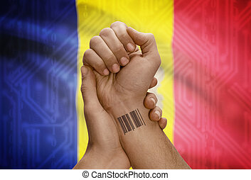 Barcode ID number on wrist of dark skinned person and national flag on background - Andorra