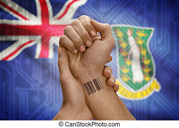 Barcode ID number on wrist of dark skinned person and national flag on background - British Virgin Islands