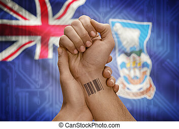 Barcode ID number on wrist of dark skinned person and national flag on background - Falkland Islands