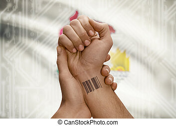 Barcode ID number on wrist of dark skinned person and USA states flags on background - Illinois