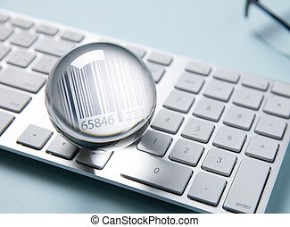 Barcode in clear crystal on white computer keyboard