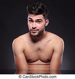 bare chest young man raises his eyebrows - young man with a...