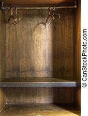 Bare cupboard - The inside of an empty wooden wardrobe