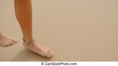 Bare Feet Coated in Sand Walking on Beach - Close Up of...