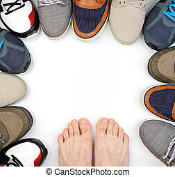 bare feet on white sneakers around isolated