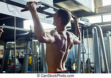 Bare Muscular Man Working Out in Gym