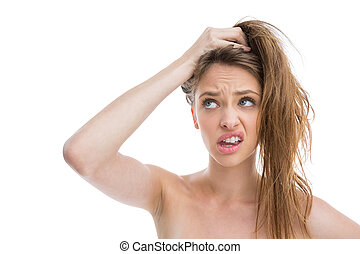 Bare natural woman making pony tail with her hair on white ...
