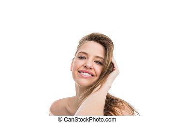Bare natural woman smiling at camera
