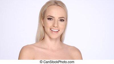 Bare Pretty Woman Smiling at the Camera