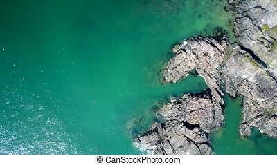 bare rocky cliffs washed by ocean water - Fantastic upper...