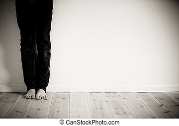 Barefeet boy alone in his room - Legs and bare feet of boy...