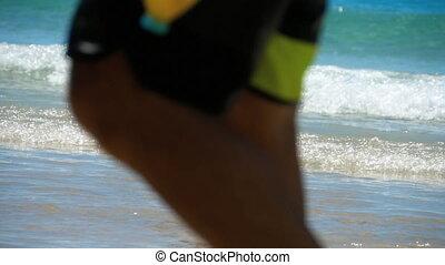 Barefoot beach walking - Woman walking barefoot on wet sand...