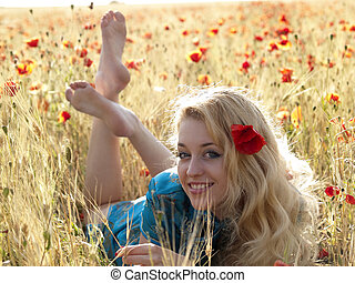 barefoot blonde in poppies beautiful barefoot blonde lady laying in poppy field picture csp2098521