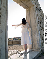 Barefoot Girl Looking Straight Holding Ancient Ruins -...